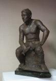 """Susan Zurles, """"Stone Cutter"""", patinated terra-cotta, 20x12, $2,200"""