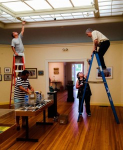Volunteers installing new LED lights throught gallery