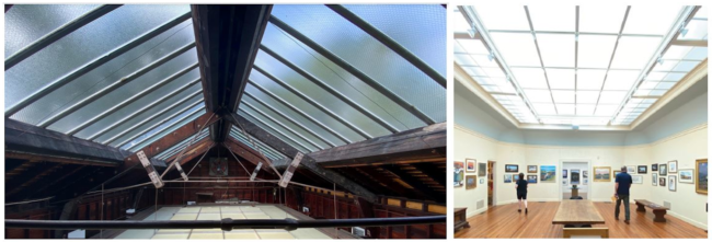 A view of the attic of the Lyme Art Association, with skylights above and laylights below that bathe the galleries in natural light.