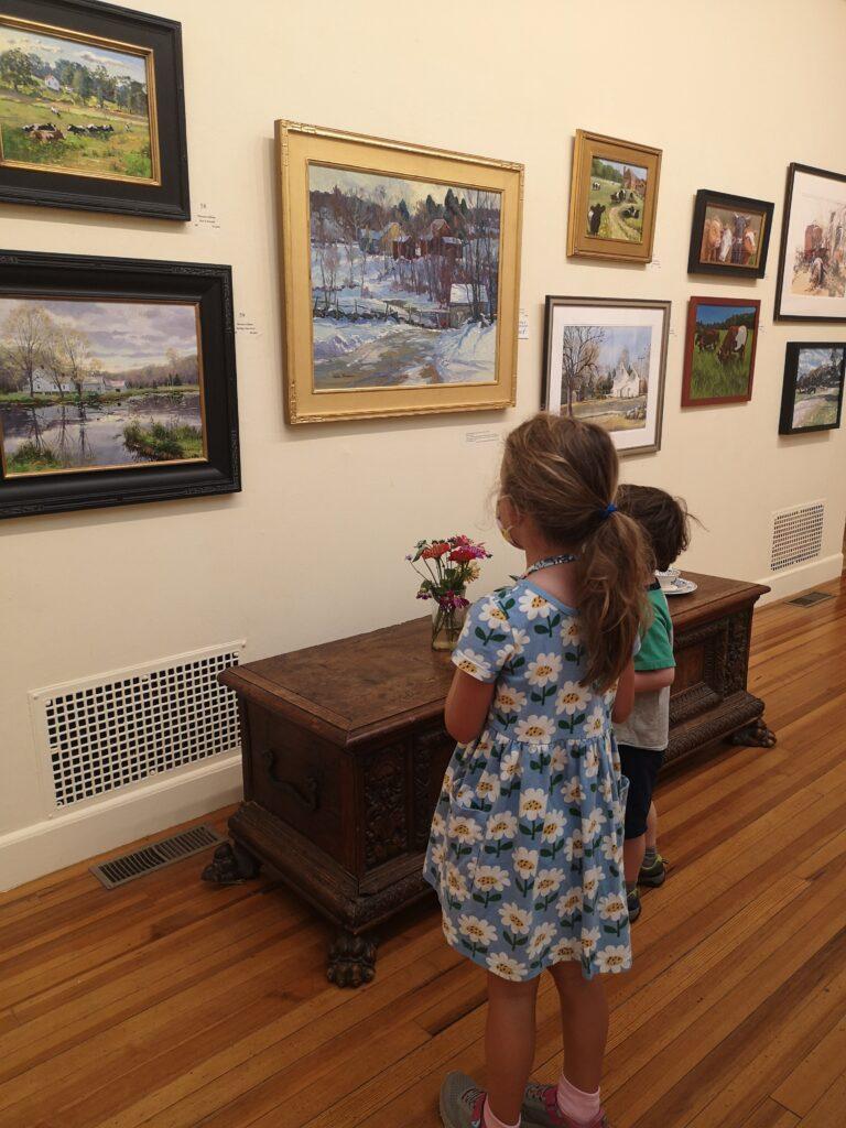 Children visiting A Century of Inspiration exhibit