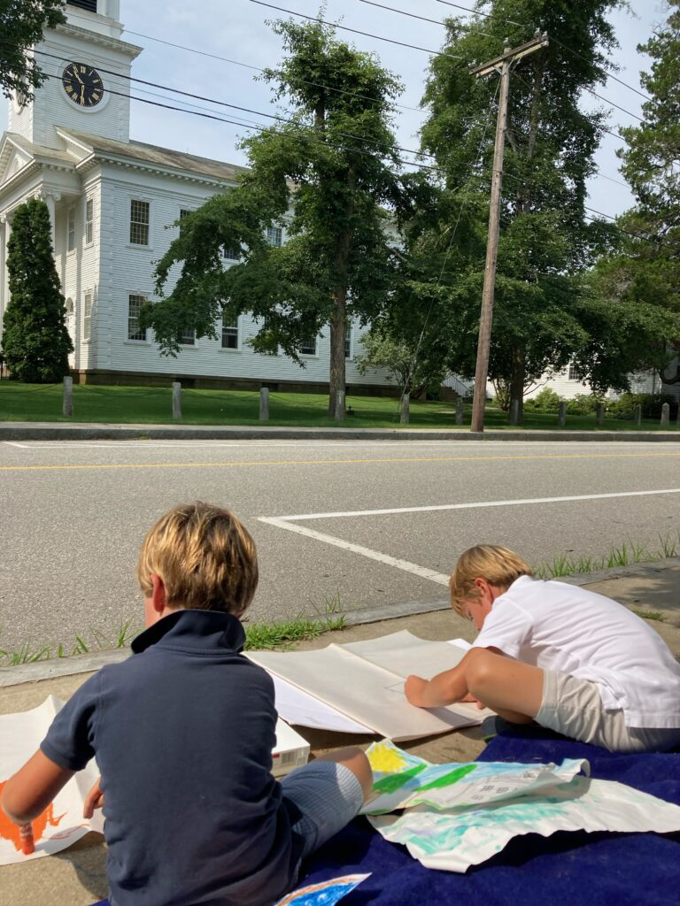 Young artists working en plein air outside Congregational Church in Old Lyme